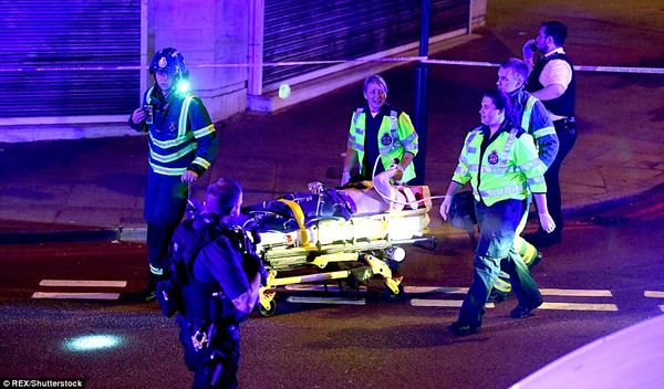 4189C74C00000578 4616452 A pedestrian is wheeled away on a stretcher by paramedics as the a 73 1497840228228