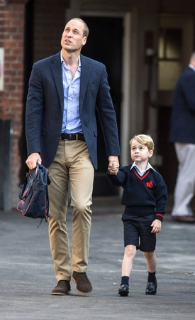 Britains Prince George accompanied by B