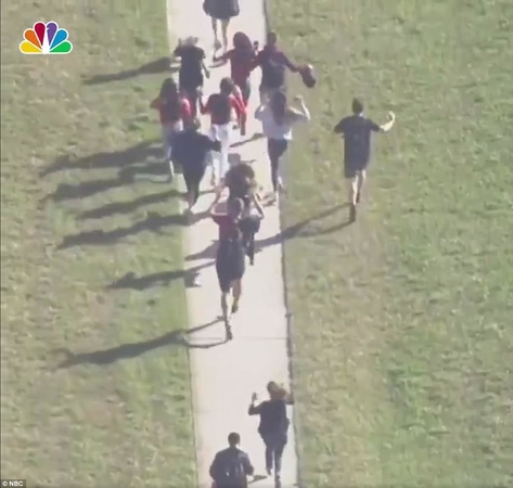 49383E5400000578 5392559 The students sprinted away from the building and gathered at the a 3 1518648002953