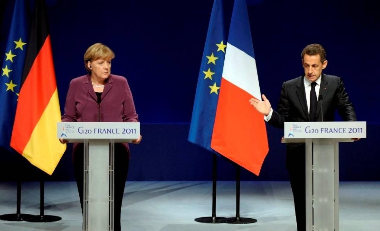 Μέρκελ – Σαρκοζί: Δείχνουν έξοδο από το ευρώ