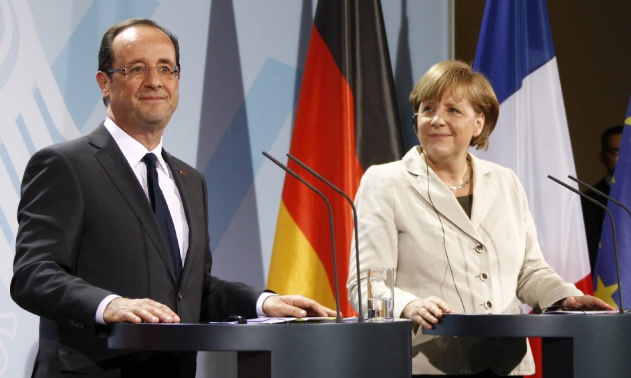 Μερκελ-Ολάντ: Θέλουμε την Ελλάδα στο ευρώ