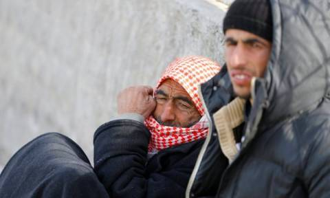 On Turkish side of border, Syrian refugees wait and worry