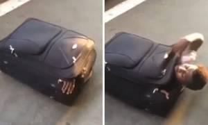 Μετανάστης ταξίδεψε από την Ιταλία στην Ελβετία μέσα σε... βαλίτσα! (pics+vid)
