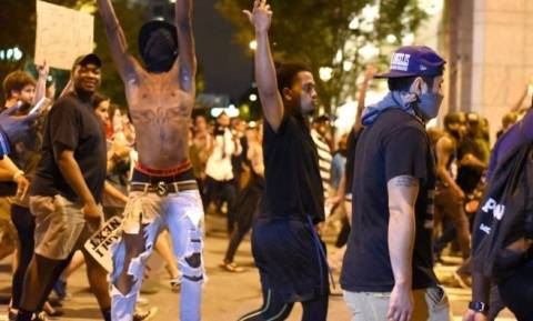 Charlotte protests diminish early on Friday as family views video