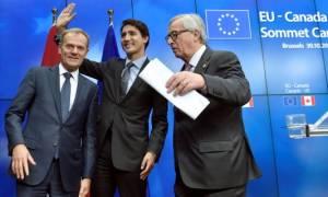 «Ικανοποίηση» για την υπογραφή της Συμφωνίας Ελεύθερου Εμπορίου με τον Καναδά
