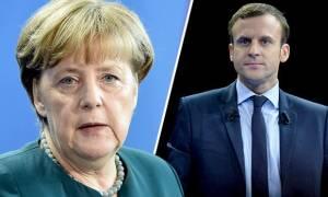 Η Μέρκελ συζητά το ενδεχόμενο να συναντηθεί με τον Μακρόν πριν από τις γαλλικές προεδρικές εκλογές