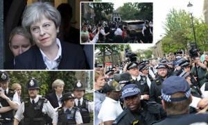 Βρετανία: Αποδοκιμασίες στη Μέι - Aποχώρησε με αστυνομική συνοδεία (pics+vid)