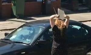 Έμαθε πως την απατά και άρχισε να καταστρέφει την BMW του! (video)