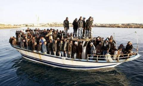 Wooden boat with 103 refugees and migrants located off Crete