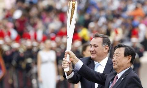 Olympic flame is handed over to South Korea Winter Games organisers during ceremony in Athens