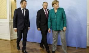 Μακρόν, Μέρκελ και Πούτιν θα συζητήσουν για την εκεχειρία στη Συρία