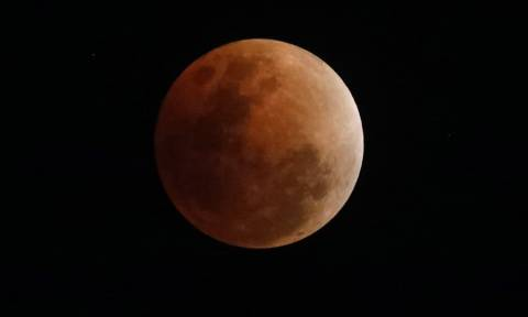 "Lunar eclipse: Skygazers await century's longest ""blood moon"""