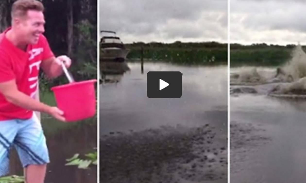 Έριξε έναν κουβά νερό στη λίμνη - Αυτό που ακολούθησε είναι τρομακτικό (vid)