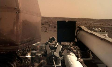 Nasa's Mars lander sends back first picture from red planet